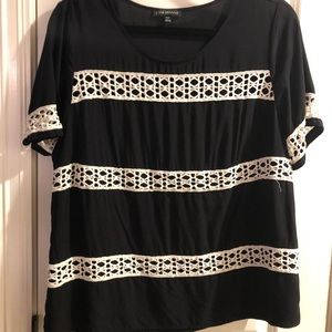 Black top with white crochet detail